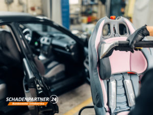 Kindersitz Auto Unfall Werkstatt